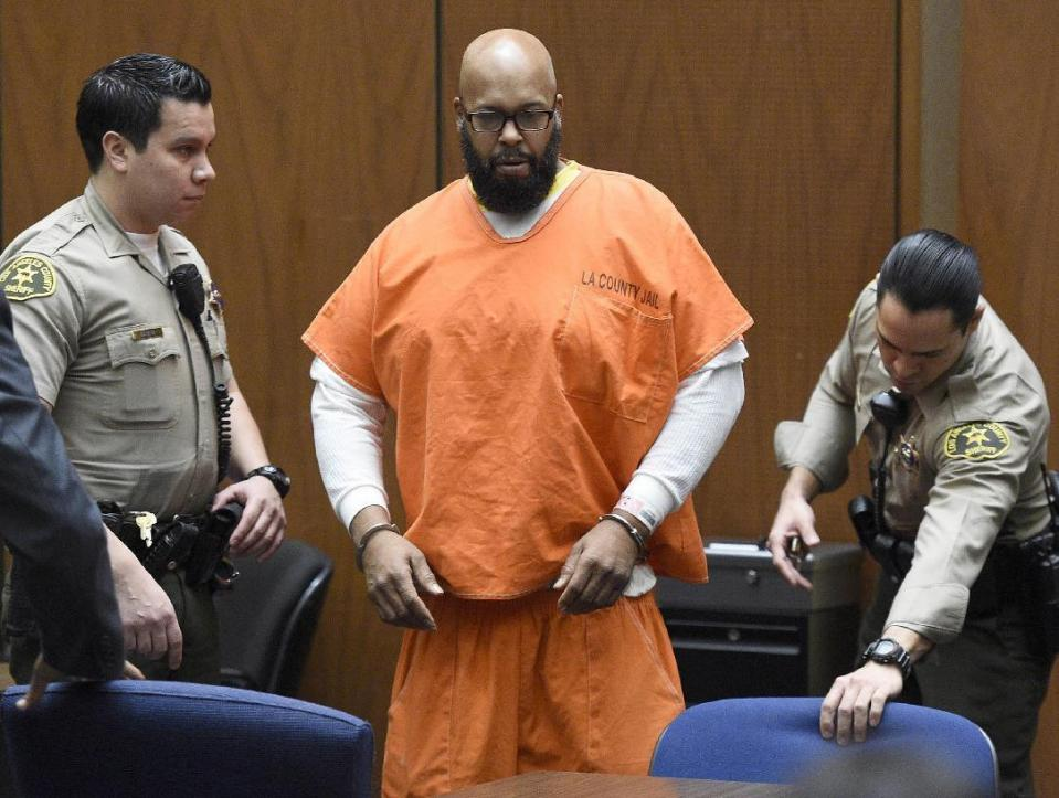 "In this March 9, 2015 file photo, Marion ""Suge"" Knight, center, arrives in court for a hearing about evidence in his murder case, in Los Angeles."