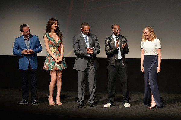 """(L-R) Producer Louis D'Esposito, actress Claudia Kim, actor Anthony Mackie, actor Don Cheadle, and actress Elizabeth Olsen appear onstage during the world premiere of Marvel's """"Avengers: Age Of Ultron"""" at the Dolby Theatre on April 13, 2015 in Hollywood, California"""