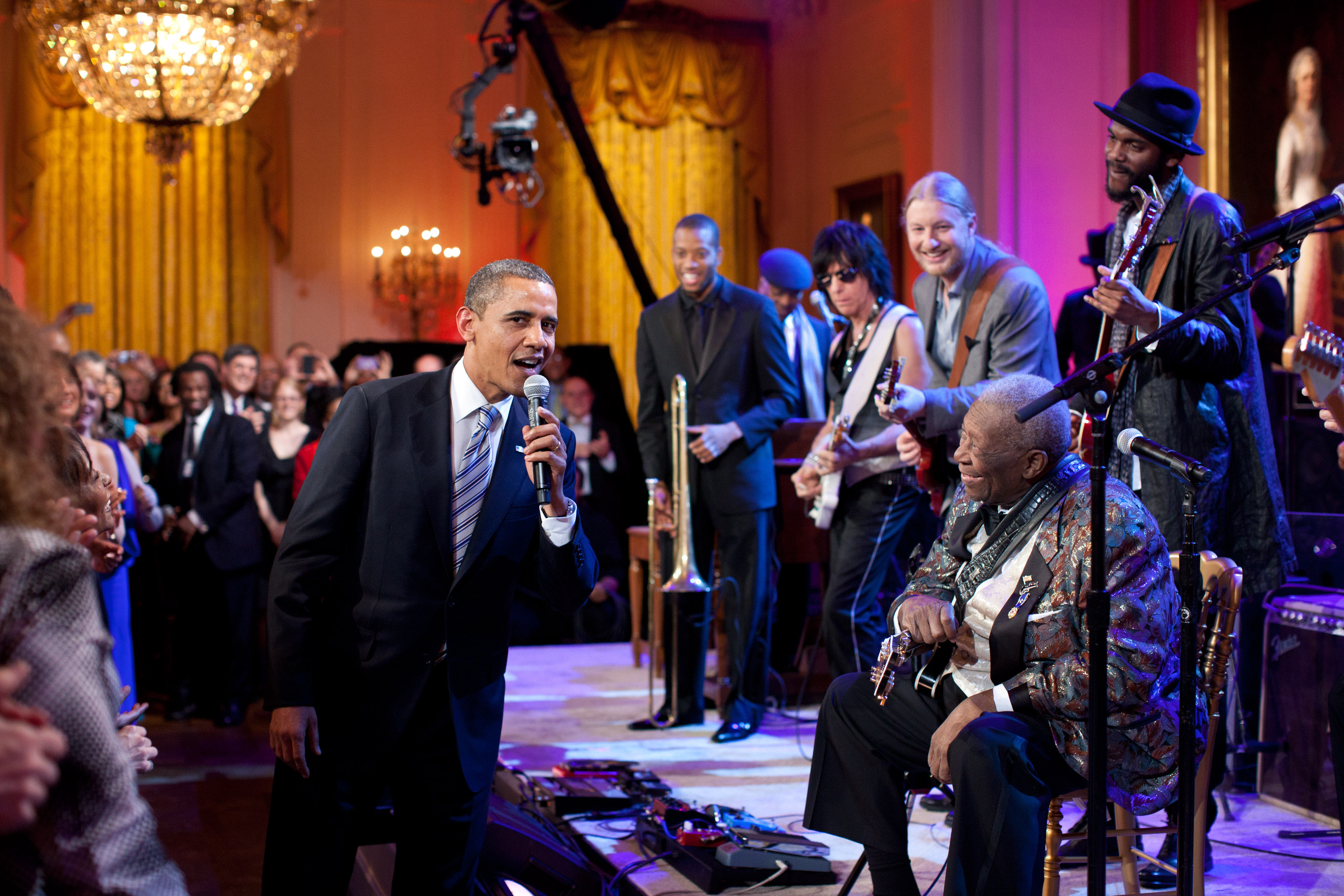 President Obama joins B.B. King (seated) in singing Sweet Home Chicago during the In Performance at the White House: Red, White and Blues concert in the East Room of the White House, Feb. 21, 2012.