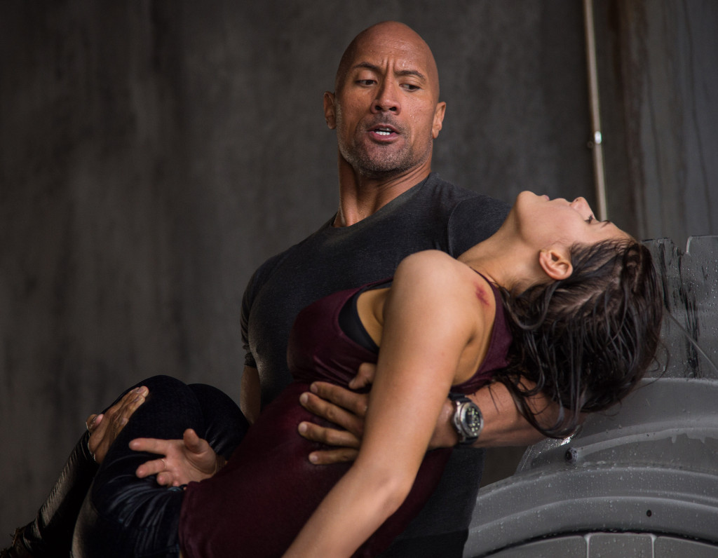 The Rock to the rescue  (Dwayne Johnson carries  unconscious daughter  Alexandra Daddario) in San Andreas.