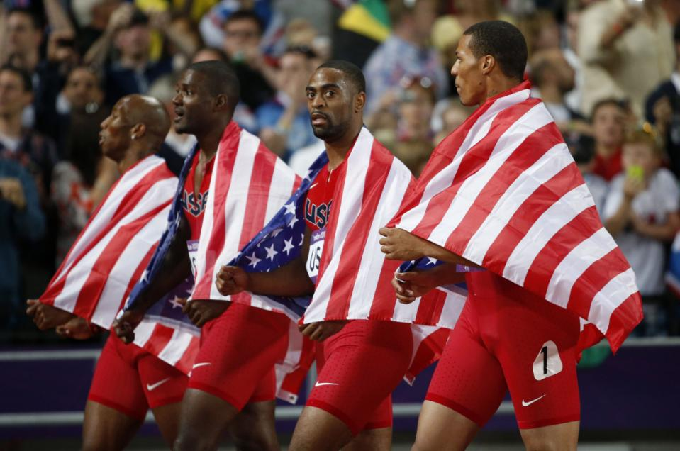 In this Saturday, Aug. 11, 2012 file photo, from left, United States' 4x100-meter relay team Trell Kimmons, Justin Gatlin, Tyson Gay and Ryan Bailey walk on the track taking the silver medal during the athletics in the Olympic Stadium at the 2012 Summer Olympics, London.