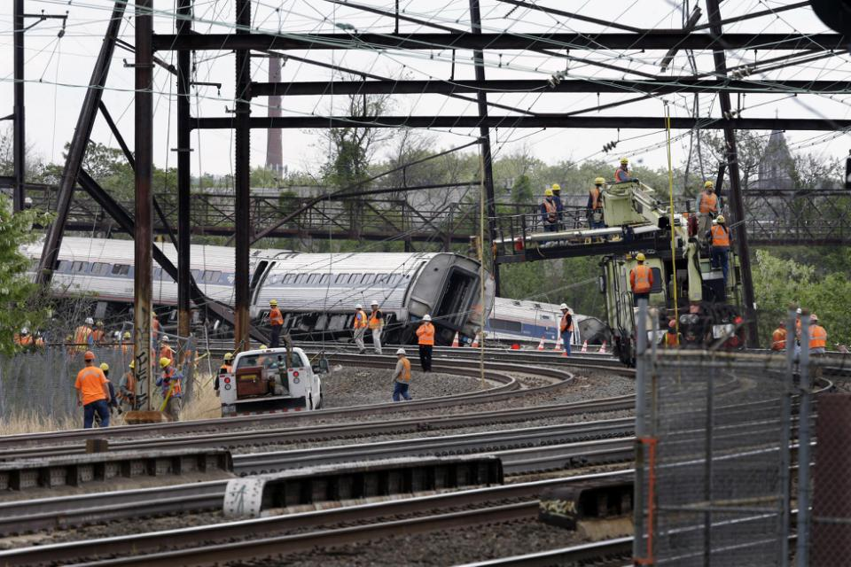 Emergency personnel gather near the scene of a deadly train wreck, Wednesday, May 13, 2015, after a fatal Amtrak derailment Tuesday night, in the Port Richmond section of Philadelphia