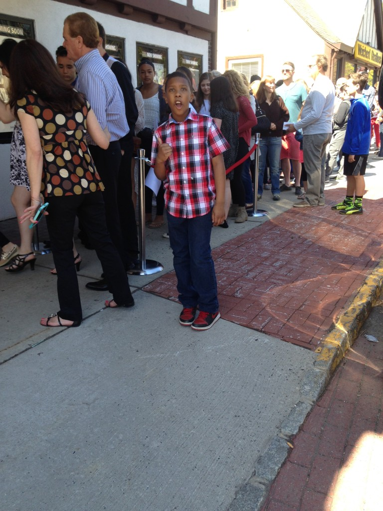 Nine year-old actor Anthony Michael Hobbs in front of the screening line to see  his short film One Nation at the Montclair Film Festival where he won Grand Prize. (Photo Credit: Kayla Elderidge)