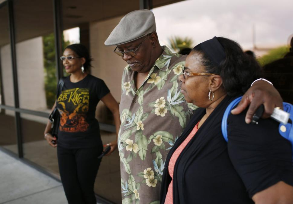 Rita Washington, from left, Willie King and Barbara King Winfree stand outside of a funeral home after a private family viewing of their father B.B. King on Thursday.