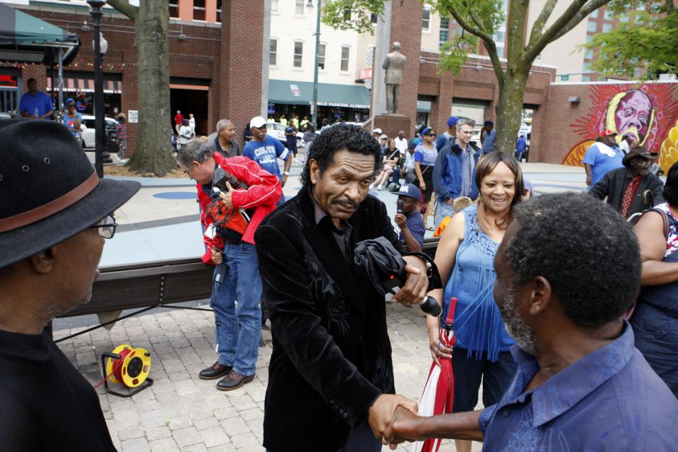 Bluesman Bobby Rush, center, is on hand for a tribute to his friend, blues musician B.B. King in W.C. Handy Park, Wednesday, May 27, 2015, in Memphis, Tenn.