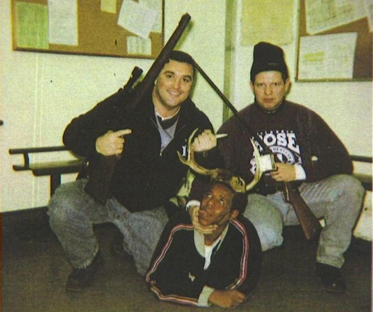 Ex-Chicago cops Jerome Finnigan (left0 and Timothy McDermott holding rifles over a black man in antlers (Cook County Court)