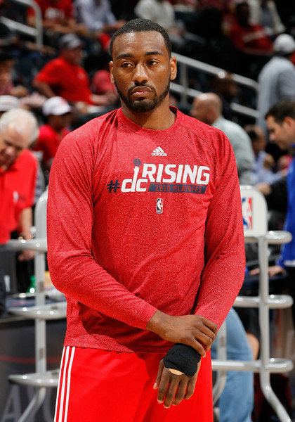 John Wall #2 of the Washington Wizards shoots around as he warms up for Game Five of the Eastern Conference Semifinals of the 2015 NBA Playoffs against the Atlanta Hawks at Philips Arena on May 13, 2015 in Atlanta, Georgia