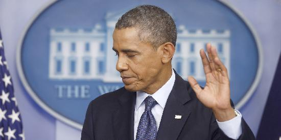 obama hand up - not happy