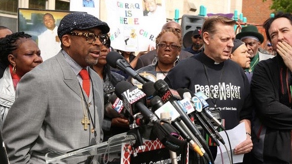 "Writer and director Spike Lee holds a press conference outside St. Sabina Church on Chicago's south side on May 14 regarding his soon-to-be-made controversial movie ""Chiraq."" Lee along with Pastor Michael Pfleger, actor John Cusack (right), and parents of victims of gun violence spoke to a large crowd in the church's courtyard."