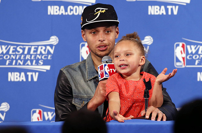 Golden State Warriors guard Stephen Curry speaks during a press conference with his daughter Riley after defeating the Houston Rockets in Game five of the NBA Western Conference Finals at Oracle Arena in Oakland, California on May 27, 2015