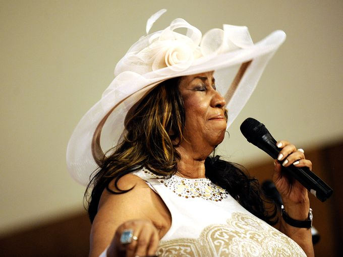 Aretha Franklin pauses as she sings during a memorial service for her father and brother, the Revs. C.L. and Cecil Franklin, at New Bethel Baptist Church in Detroit on Sunday, June 7, 2015