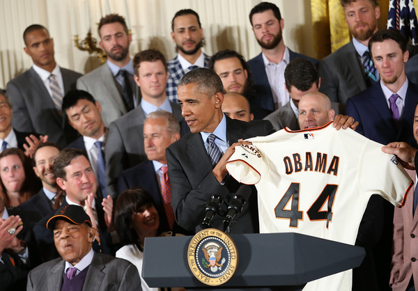 President Barack Obama receives a San Francisco Giants jersey after welcoming the World Series Champion San Francisco Giants to the White House June 4, 2015 in Washington, DC.