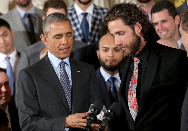 President Barack Obama (L) receives an autographed baseball from pitcher Madison Bumgarner (R) after welcoming the World Series Champion San Francisco Giants to the White House June 4, 2015 in Washington, DC