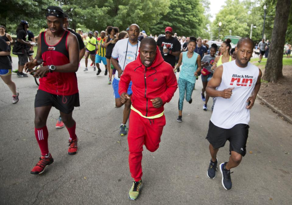 Actor and comedian Kevin Hart, center, leads an impromptu 5K run he organized on social media through Piedmont Park Friday, June 12, 2015, in Atlanta.