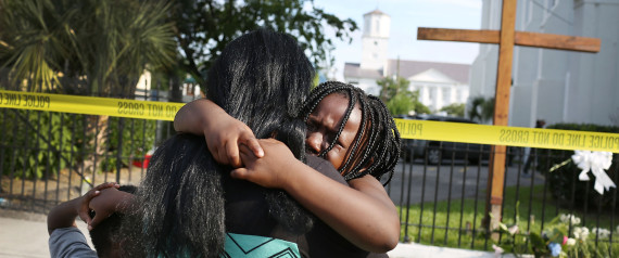 CHARLESTON, SC - JUNE 19: Kearston Farr comforts her daughter, Taliyah Farr,5, as they stand in front of the Emanuel African Methodist Episcopal Church after a mass shooting at the church that killed nine people of June 19, 2015.