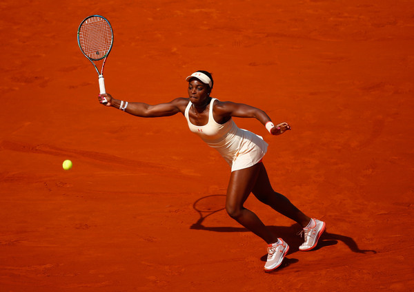 Sloane Stephens of the United States returns a shot in her Women's Singles match against Serena Williams of the United States on day nine of the 2015 French Open at Roland Garros on June 1, 2015 in Paris, France