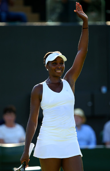 Venus Williams of the United States celebrates winning her Ladies' Singles first round match against Madison Brengle of the United States during day one of the Wimbledon Lawn Tennis Championships at the All England Lawn Tennis and Croquet Club on June 29, 2015 in London, England