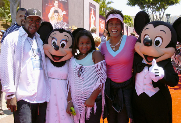 "tney Houston, Bobby Brown and their daughter Bobbi Kristina are greeted by Mickey Mouse and Minnie Mouse for the premiere of ""The Princess Diaries 2"" at the Disneyland Resort August 7, 2004 in Anaheim, California"
