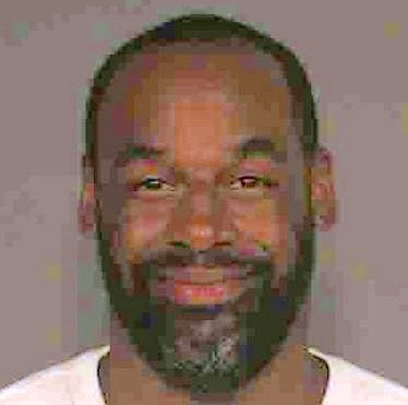 This June, 2015, photo provided by the Gilbert, Ariz., Police Department shows former NFL quarterback Donovan McNabb. Police in the Phoenix suburb of Gilbert said Tuesday, July 5, 2015, that McNabb was cited and released from a police facility after being arrested on June 28, 2015, following a non-injury collision late that night. (Gilbert Police Department via AP)