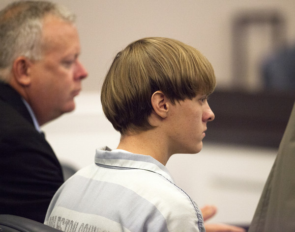 Dylann Roof (R), 21, listens to proceeding with assistant defense attorney William Maguire during a hearing at the Judicial Center July 16, 2015 in Charleston, South Carolina.