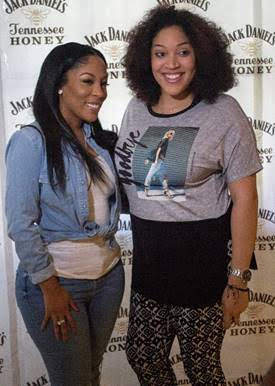 K. Michelle greets one of the Honey Jam sweepstakes winners in New Orleans. As part of the sweepstakes presented by Jack Daniel's Tennessee Honey, five of her fans won an all-expenses paid trip to join her in New Orleans for the Honey Jam concert. (Photo provided courtesy of It Was Worth It Photography /Jack Daniel's Tennessee Honey)