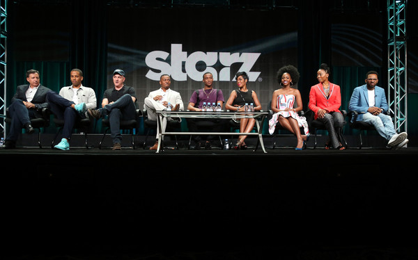 (L-R) Executive producers Tom Werner, Maverick Carter, Mike O'Malley, actors RonReaco Lee, Jessie T. Usher, Tichina Arnold, Teyonah Parris, Erica Ash and Mike Epps speak onstage during the 'Survivor's Remorse' panel discussion at the STARZ portion of the 2015 Summer TCA Tour at The Beverly Hilton Hotel on July 31, 2015 in Beverly Hills, California