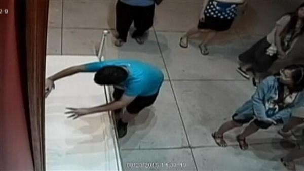 Boy trips and punches hole in painting