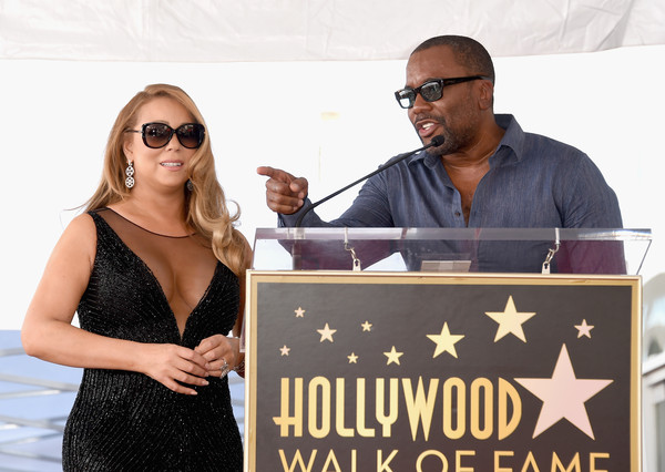 Singer Mariah Carey (L), with director/producer Lee Daniels, is honored with Star on The Hollywood Walk of Fame on August 5, 2015 in Hollywood, California