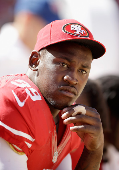 Outside linebacker Aldon Smith #99 of the San Francisco 49ers sits on the bench during a preseason game against the Denver Broncos at Levi's Stadium on August 17, 2014 in Santa Clara, California