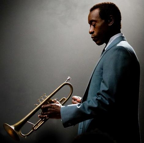 don cheadle (as miles davis with trumpet)