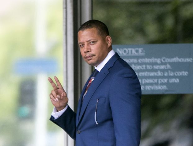 In this Thursday, Aug. 13, 2015, file photo, actor Terrence Howard walks into a Los Angeles court for a hearing regarding a divorce settlement with his ex-wife Michelle Ghent.