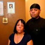 Widow Karen Fennell and her son, James Jordan, Jr. stand at front door where husband's Death Certificate is taped