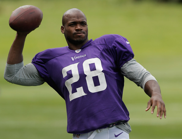 Running back Adrian Peterson in action during a Minnesota Vikings training session at the Grove Hotel on September 26, 2013 in London, England. (Source: Harry Engels/Getty Images Europe)