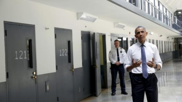 President Obama shares with reporters during visit to El Reno prison.