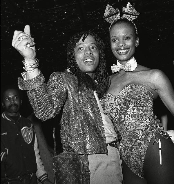 Rick James is all smiles with Playboy Bunny