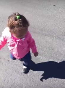 baby sees own shadow