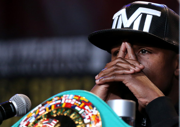 Floyd Mayweather listens at a press conference ahead of his upcoming fight with Andre Berto at JW Marriott Los Angeles at L.A. LIVE on August 6, 2015 in Los Angeles, California