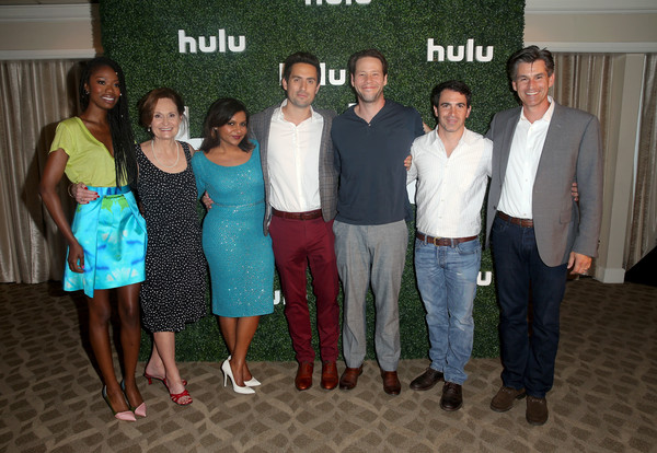 (L-R) Actors Xosha Roquemore, Beth Grant, Mindy Kaling, Ed Weeks, Ike Barinholtz, Chris Messina, and Chief Executive Officer of Hulu Mike Hopkins attend the Hulu 2015 Summer TCA Presentation at The Beverly Hilton Hotel on August 9, 2015 in Beverly Hills, California