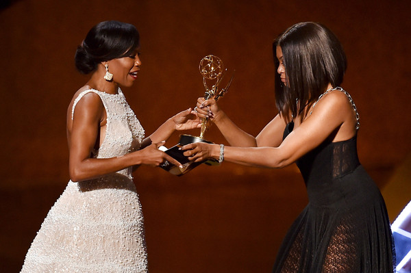 Actress Regina King (L) accepts Outstanding Supporting Actress in a Limited Series or Movie award for 'American Crime' from actress Taraji P. Henson onstage during the 67th Annual Primetime Emmy Awards at MICROSOFT Theater on September 20, 2015 in Los Angeles, California