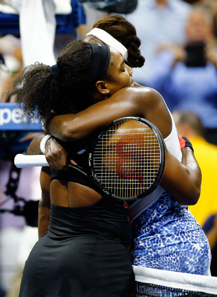 Serena Williams (L) of the United States hugs Venus Williams of the United States after defeating her in their Women's Singles Quarterfinals match on Day Nine of the 2015 US Open at the USTA Billie Jean King National Tennis Center on September 8, 2015 in the Flushing neighborhood of the Queens borough of New York City