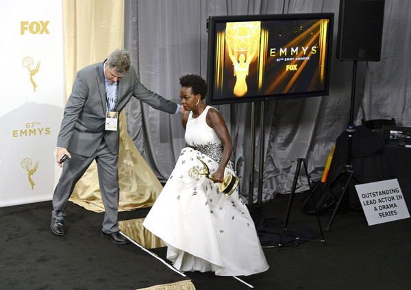 """Actress Viola Davis, winner of Outstanding Lead Actress in a Drama Series for """"How to Get Away With Murder,"""" is helped on stage in the press room at the 67th Annual Primetime Emmy Awards at Microsoft Theater on September 20, 2015 in Los Angeles, California"""