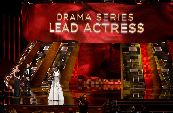 Actress Viola Davis (C) accepts Outstanding Lead Actress in a Drama Series award for 'How to Get Away with Murder' from actor Adrien Brody (L) onstage during the 67th Annual Primetime Emmy Awards at Microsoft Theater on September 20, 2015 in Los Angeles, California.