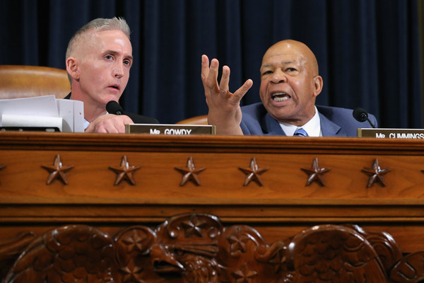 House Select Committee on Benghazi Chairman Trey Gowdy (R-SC) (L) and ranking member Rep. Elijah Cummings (D-MD) argue during a hearing where Democratic presidential candidate and former Secretary of State Hillary Clinton testifies October 22, 2015 on Capitol Hill in Washington, DC.