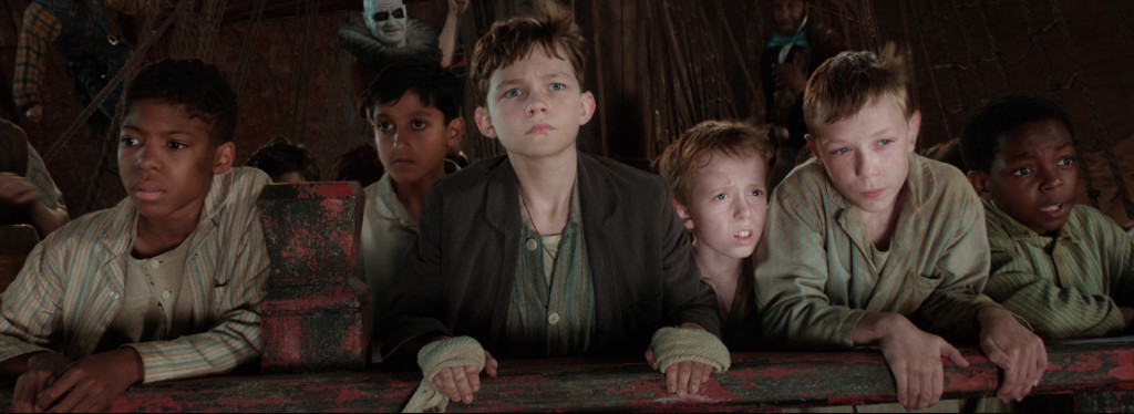 Levi Miller as Peter (Center) and fellow orphans.