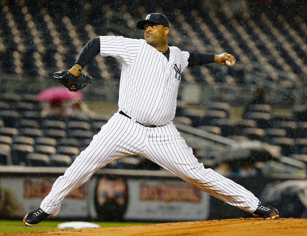 CC Sabathia #52 of the New York Yankees pitches against the Boston Red Sox during their game at Yankee Stadium on October 1, 2015 in New York City.