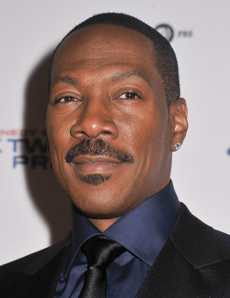 Honoree Eddie Murphy poses on the red carpet during the 18th Annual Mark Twain Prize For Humor at The John F. Kennedy Center for Performing Arts on October 18, 2015 in Washington, DC