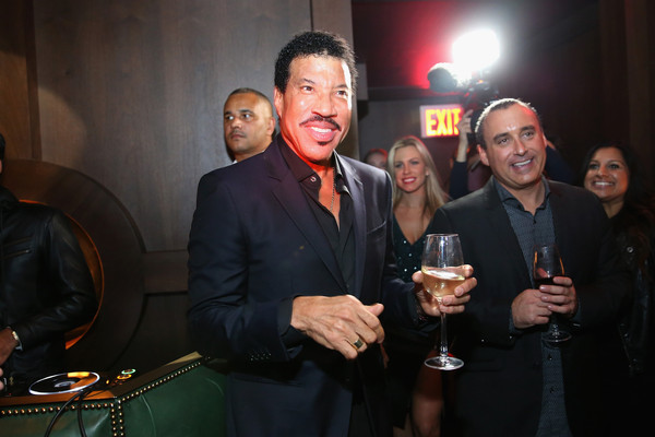 Lionel Richie (L) and Rob Berman Founder and President at Impulse! attend Jason Binn's DuJour Magazine and Lionel Richie Home Collection launch with IMPULSE! International at PHD Terrace at Dream Midtown on October 27, 2015 in New York City.