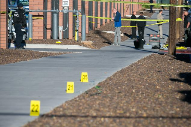 Police officers investigate a shooting at Northern Arizona University campus in Flagstaff, Ariz..