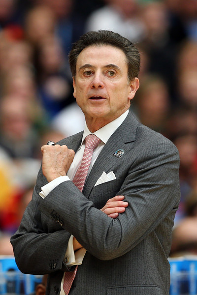 Head coach Rick Pitino of the Louisville Cardinals looks on the first half of the game against the Michigan State Spartans during the East Regional Final of the 2015 NCAA Men's Basketball Tournament at Carrier Dome on March 29, 2015 in Syracuse, New York