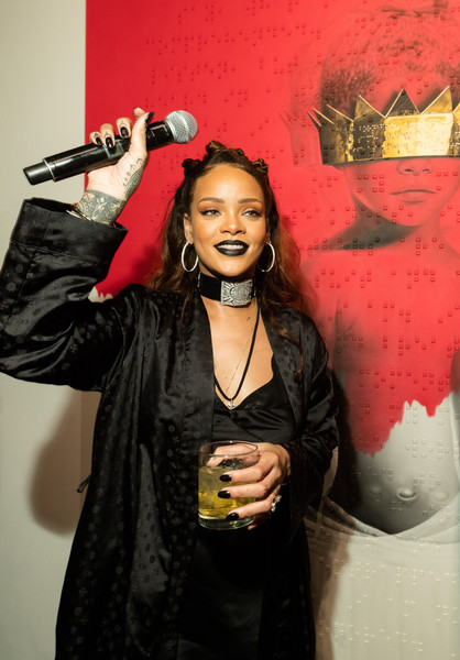 "Singer Rihanna (L) and artist Roy Nachum at Rihanna's 8th album artwork reveal for ""ANTI"" at MAMA Gallery on October 7, 2015 in Los Angeles, California"